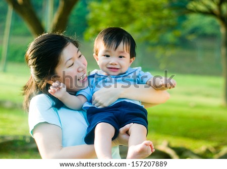 Asian mother and baby - stock photo