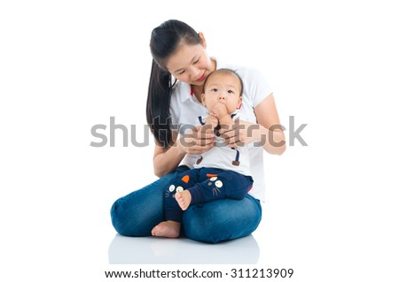 Asian mother and baby indoor portrait - stock photo