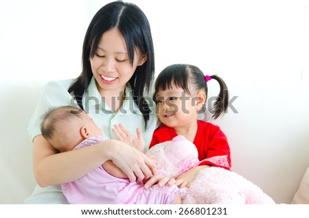 Asian mother and children - stock photo