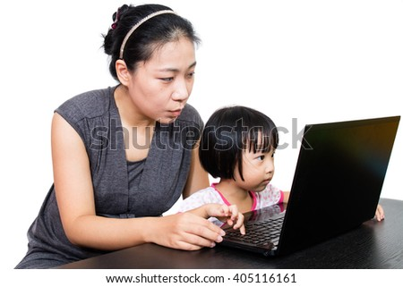 Asian Mother and Daughter Using Laptop Computer in Isolated White Background