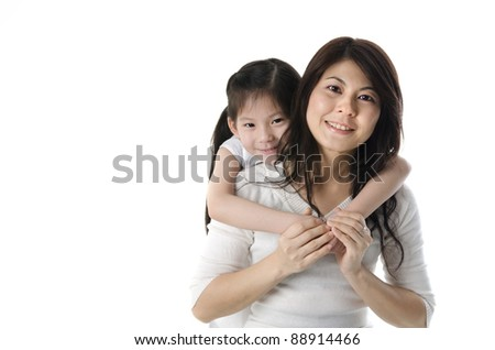 asian mother and daugther with white background - stock photo