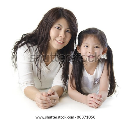 Asian mother and her daughter on white background - stock photo