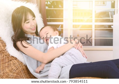 Asian mother and his cute little boy