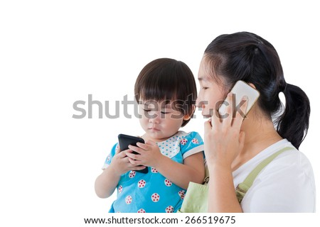 Asian mother carrying  her daughter, child holding electronic gadget, mother using mobile phone. Modern technology in home, some space for input text message, isolated on white background - stock photo
