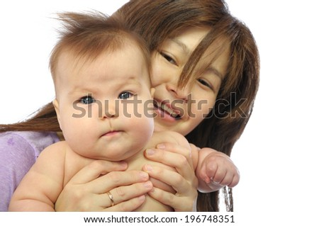 Asian mother holding baby isolated on white background. Mother and newborn baby, mom and newborn baby. Happy lovely motherhood, happiness family portrait