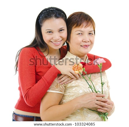 Asian mother holding carnation flower with her daughter isolated on white background - stock photo