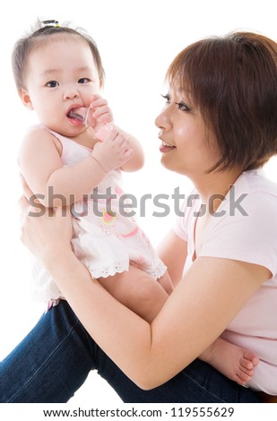 Asian mother holding her baby girl - stock photo
