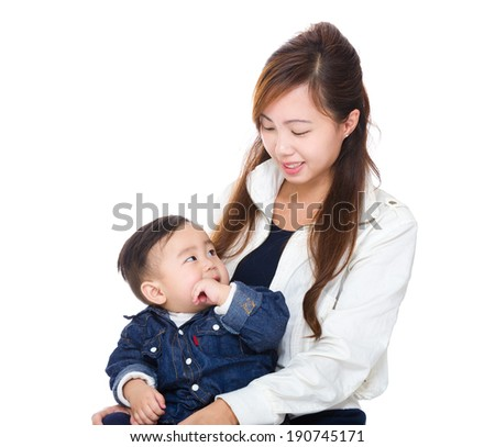 Asian mother looking at her son - stock photo