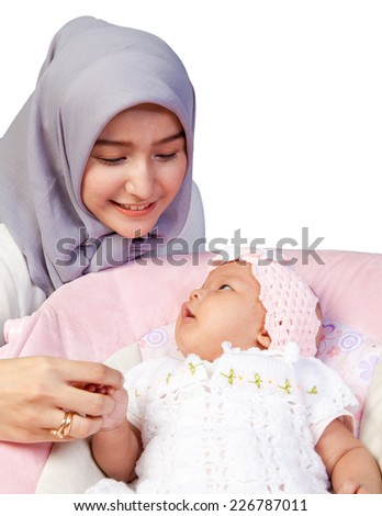 Asian Mother Muslim with her newborn baby girl - stock photo