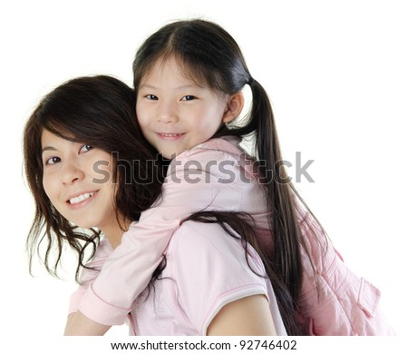 Asian mother piggyback her daughter, on white background - stock photo