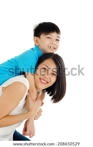 Asian mother piggyback her son