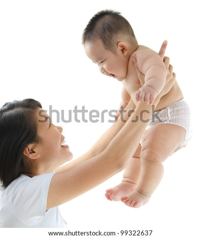 Asian mother playing with her baby boy