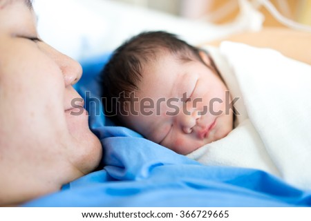 Asian mother with newborn baby in the hospital