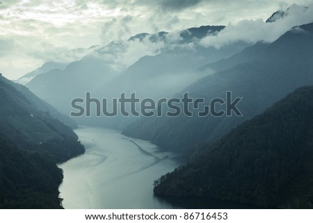 Asian mountain valley fog with river - stock photo
