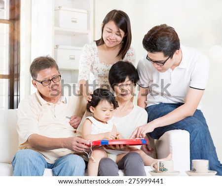 Asian multi generations having fun at home. Happy family portrait. - stock photo