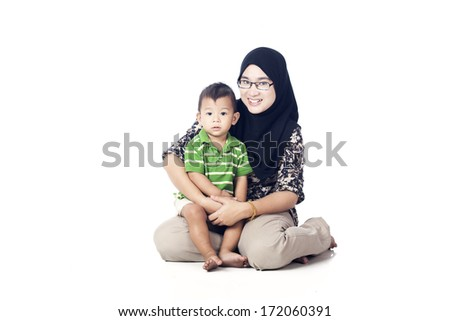 Asian Muslim mother posing with her little baby - stock photo
