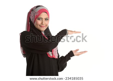 Asian Muslim woman present something isolated on white background. - stock photo