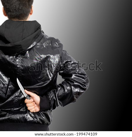Asian mysterious man hide knife in the back, isolated