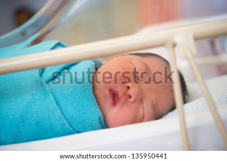 Asian Newborn baby girl 1 day after the birth, in hospital. - stock photo