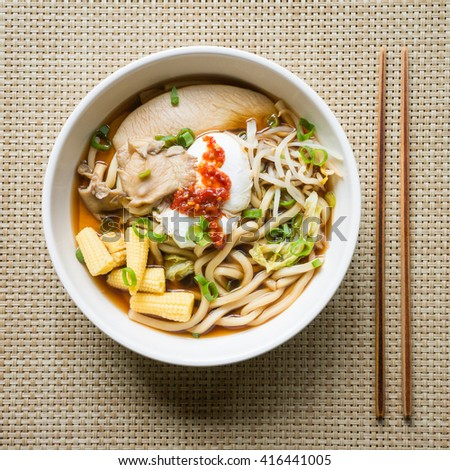 Asian noodle soup from above with chopsticks