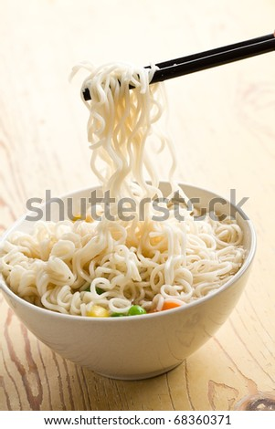 asian noodle soup on kitchen table - stock photo