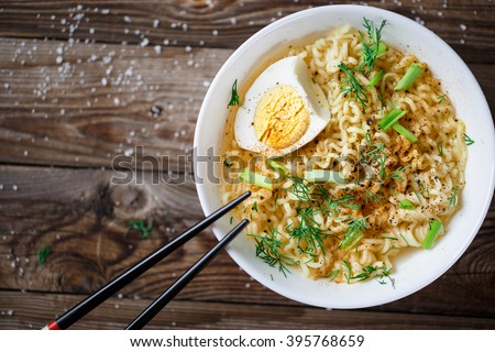 Asian noodles with fresh green onion and boiled egg - stock photo
