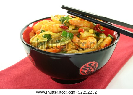Asian noodles with prawns and stir-fried vegetables in an Asian dish - stock photo