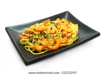 Asian noodles with shrimp and vegetable stir-fry on Asian dishes - stock photo