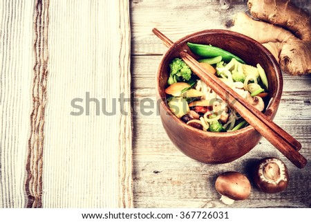 Asian noodles with stir-fried vegetables. Food background with copyspace - stock photo