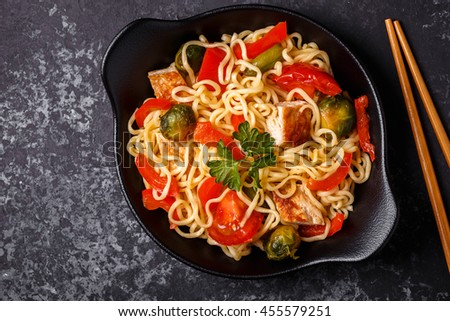 Asian noodles with vegetables and chicken, top view. - stock photo