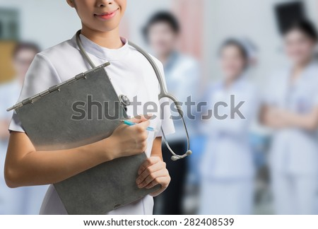 Asian nurse holding a steel file. To save the patient's situation hospital backdrop - stock photo