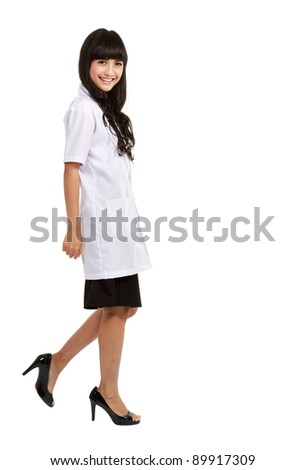 asian nurse or young medical doctor smiling in full length. - stock photo