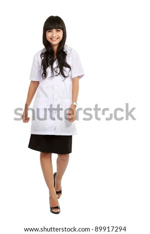 asian nurse or young medical doctor walking smiling in full length. - stock photo