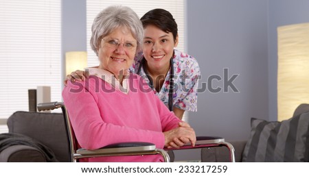 Asian nurse smiling with Elderly patient - stock photo