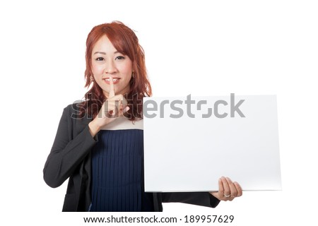 Asian office girl  showing hand silence sign with a blank sign - stock photo