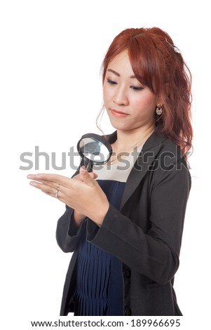 Asian office girl  use magnifying glass for watching her own the hand  - stock photo