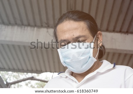 Asian Old man wear face mask medical protection in factory.