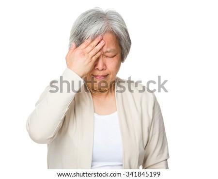 Asian Old woman feeling headache - stock photo