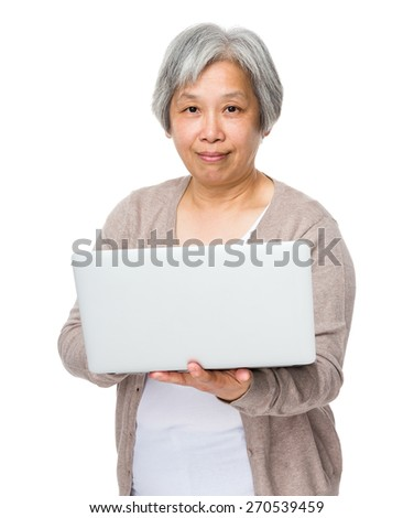 Asian old woman learn to use of laptop - stock photo