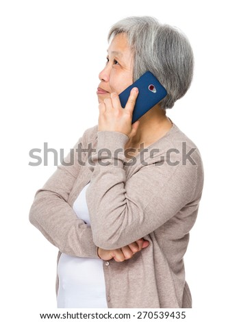 Asian Old woman use of cellphone - stock photo