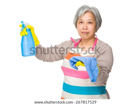 Asian old woman use of detergent fo cleaning  - stock photo