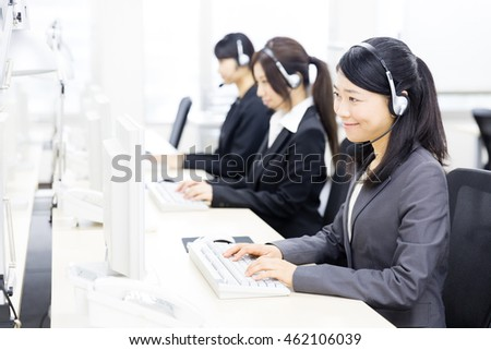 asian operator working in the office