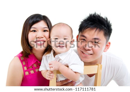 Asian parent and their baby boy - stock photo