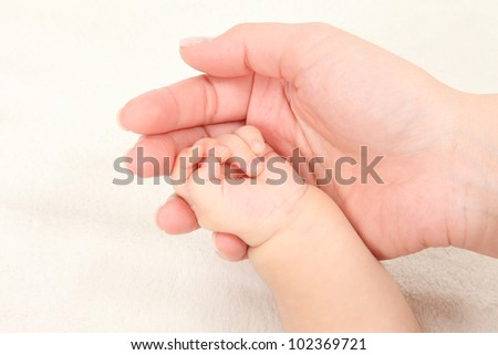 Asian parents and children hold hands in white background - stock photo