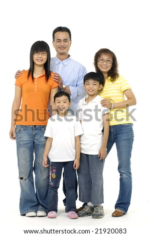 Asian parents with three children standing in front of white background