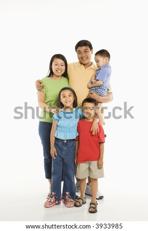 Asian parents with three children standing in front of white background. - stock photo