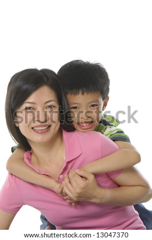 Asian portrait of happy young family - stock photo