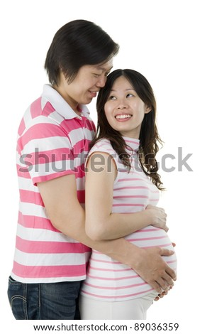 Asian pregnant woman looking at her husband