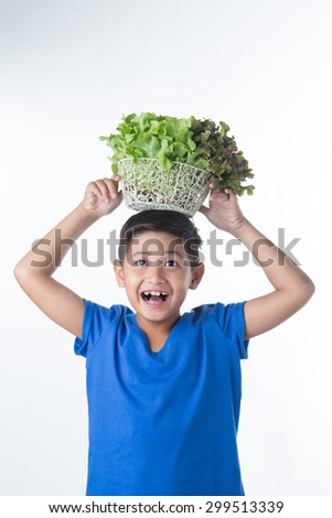 Asian Pretty boy Holding vegetables on his head - stock photo