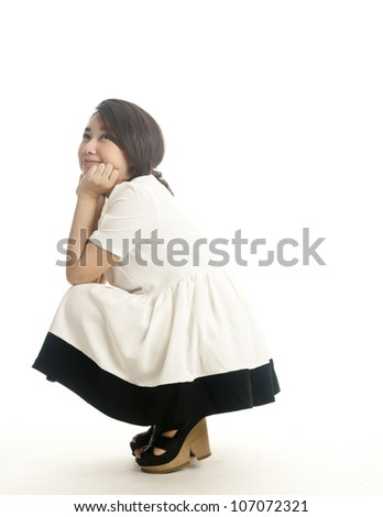 asian pretty girl dreaming or thinking isolated on white background - stock photo